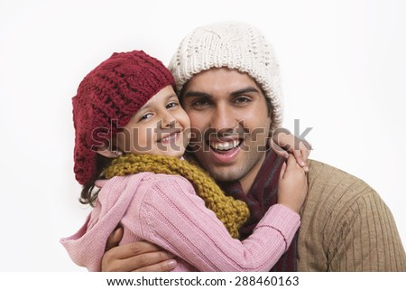 Close-up of daughter and father embracing - stock photo