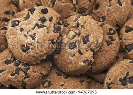 Close up of delicious chocolate chip cookies background. - stock photo