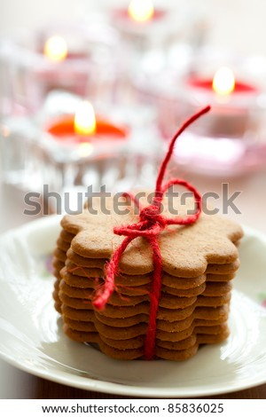 Close-up of delicious Christmas gingerbread cookies with candles - stock photo