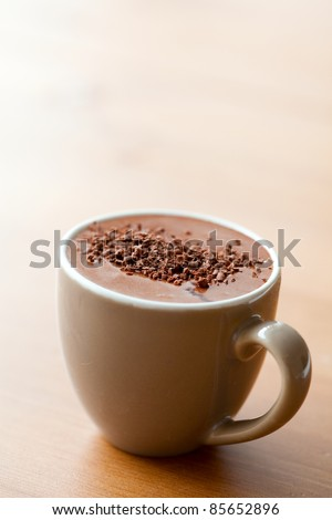 Close-up of delicious hot chocolate with chocolate sprinkles - stock photo