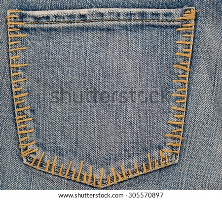 Close up of  denim jeans patch pocket - stock photo