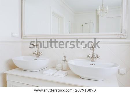 Close-up of designed washbasins in retro bathroom - stock photo