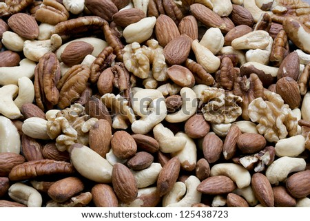 Close-up of different kinds of peeled nuts - stock photo
