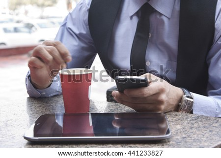 Close-up of digital tablet coffee and mobile phone INDIA DELHI - stock photo