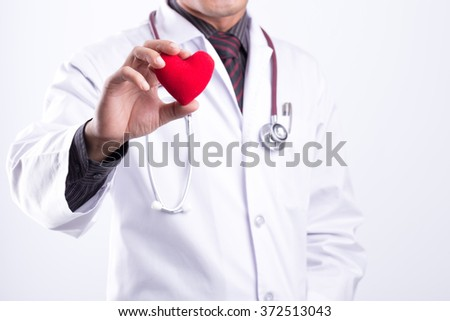 close up of doctor hands with heart - stock photo