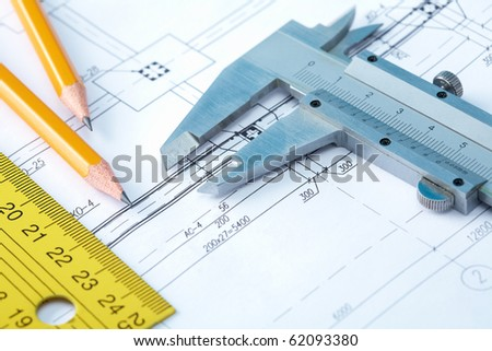 Close-up of draft with pencils and rulers - stock photo