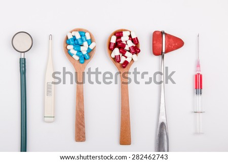 Close up of drug and medical tool - stock photo