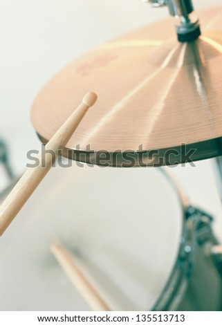 Close up of drum kit with cymbal and drumsticks - stock photo