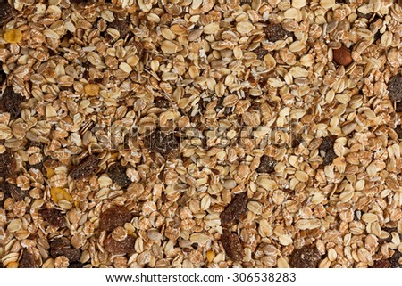 Close-up of dry muesli with nuts and raisins from above  - stock photo