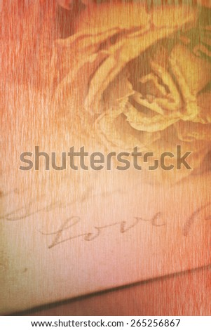 Close up of dry rose and Love word written on card. Soft light vintage style, paper texture image. - stock photo