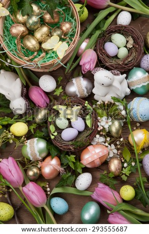 Close up of Easter assortiment of Easter eggs, spring flowers, and toys.