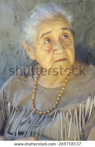 Close-up of elderly Native American woman wearing necklace, Tasalagi, Cherokee Nation, OK - stock photo