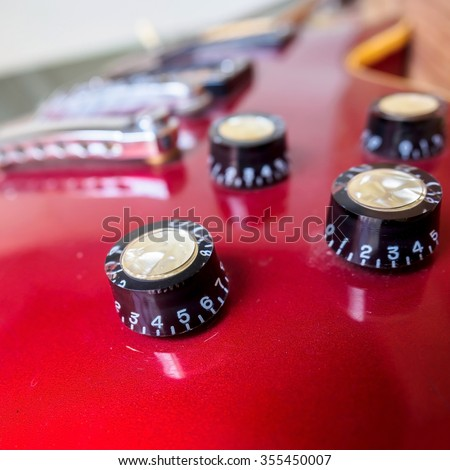 Close up of electric guitar volume knob - stock photo