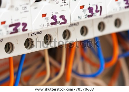 Close-up of electrical fuseboxes and power lines - stock photo