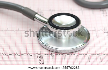 Close up of electrocardiograph with stethoscope - stock photo
