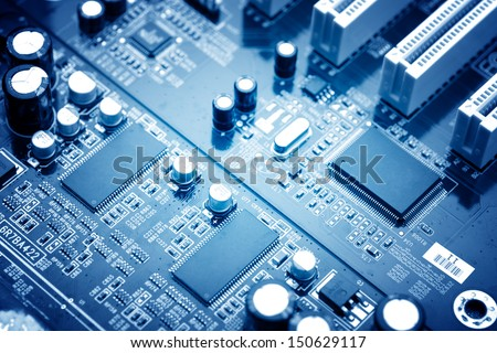 close-up of electronic circuit board with processor - stock photo