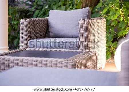 Close up of elegant rattan garden furniture - stock photo