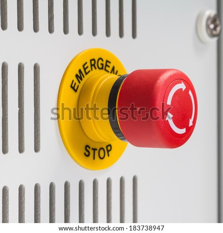 Close up of emergency stop button switch, an electrical device for safety - stock photo
