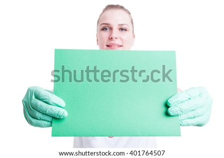 Close-up of empty green card or paper in female surgeon or doctor hands with copy space isolated on white background - stock photo