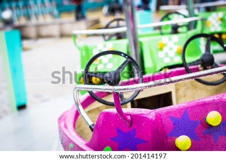Close up of empty wet car carousel on rainy day. Selective focus  - stock photo