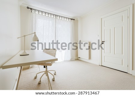 Close-up of empty worktable in cream room - stock photo