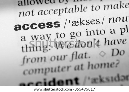 Close up of English dictionary page with word access - stock photo