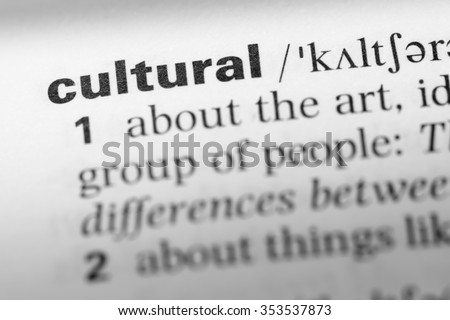 Close up of English dictionary page with word cultural - stock photo