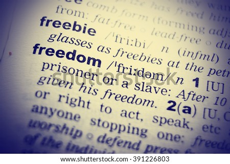 Close up of English dictionary page with word freedom - stock photo