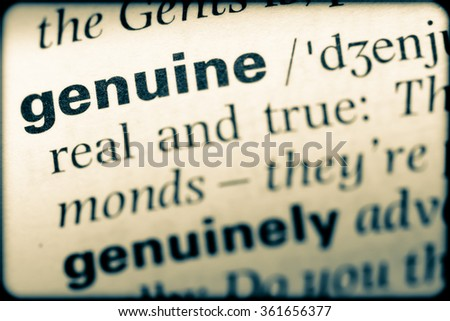 Close up of English dictionary page with word genuine - stock photo