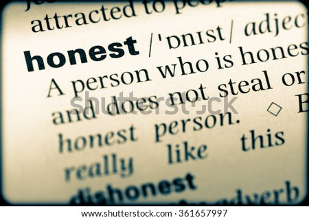 Close up of English dictionary page with word honest - stock photo