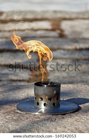 Close up of Eternal Flame at John F. Kennedy's grave in Arlington National Cemetery - stock photo