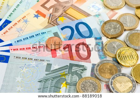 close up of euro currency. coins and banknotes. money background - stock photo