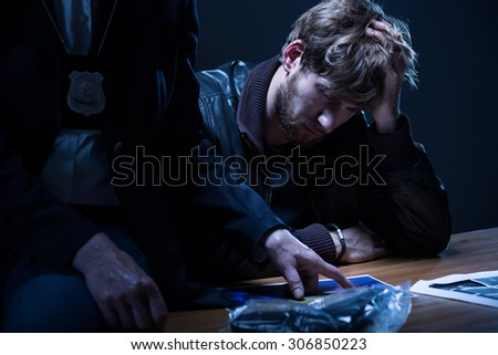 Close-up of evidence of crime in interrogation room - stock photo