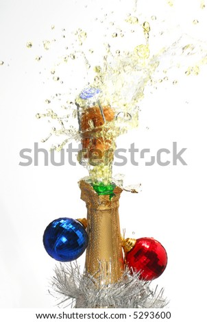 Close-up of explosion of Christmas champagne bottle cork - stock photo