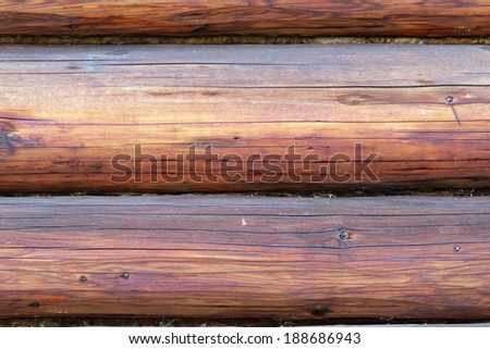 close up of exterior spruce beams on wooden lodge - stock photo
