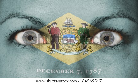 Close up of eyes. Painted face with flag of Delaware - stock photo