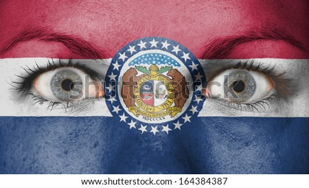 Close up of eyes. Painted face with flag of Missouri - stock photo