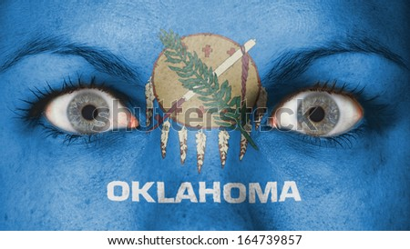 Close up of eyes. Painted face with flag of Oklahoma - stock photo
