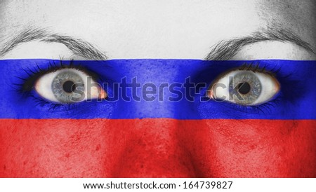 Close up of eyes. Painted face with flag of Russia - stock photo
