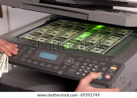 Close up of fake money on copy machine in office - stock photo