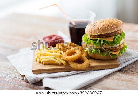 close up of fast food snacks and drink on table - stock photo