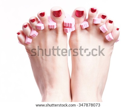 Close-up of female feet with red polished nails chiropody - stock photo