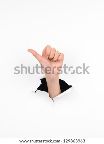 close-up of female hand coming out from a hole in a paper, counting number one gesture, isolated on white - stock photo