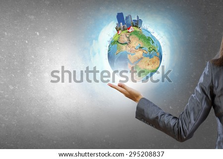 Close up of female hand holding our Earth planet. Elements of this image are furnished by NASA - stock photo