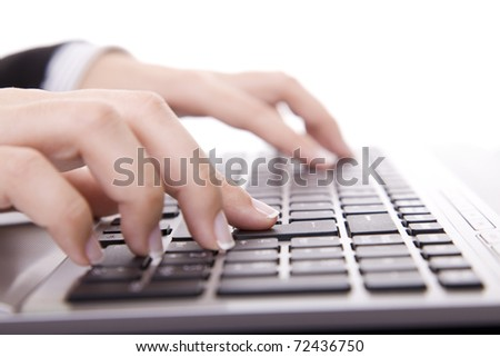 Close-up of female hand touching buttons of computer keyboa - stock photo