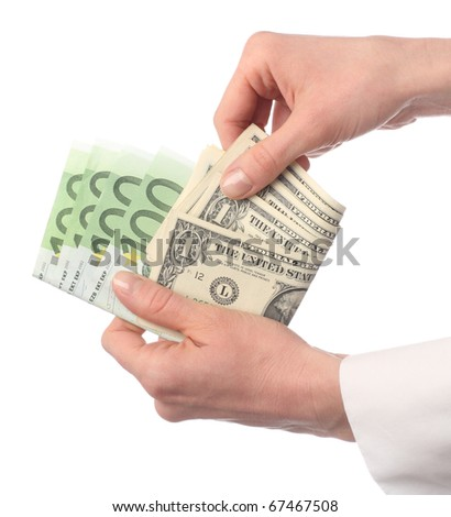 Close-up of female hands holding banknotes: choosing dollar; isolated on white - stock photo