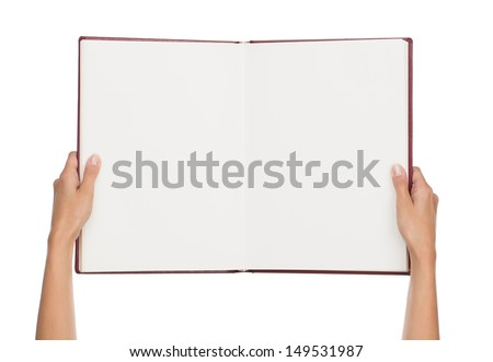 Close up of female hands holding blank book isolated on white background with copy space - stock photo