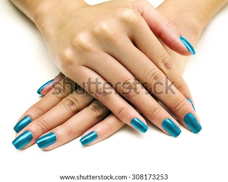 Close up of female hands showing colorful nail polish on white background.  The woman is wearing aqua blue manicure. - stock photo