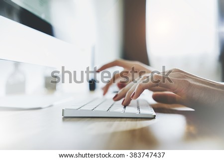 Close up of female hands typing on white keyboard, woman working at office and using modern computer and keyboard - stock photo