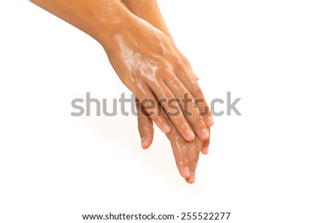 Close-up of female hands while applying oil on white background view 2 - stock photo